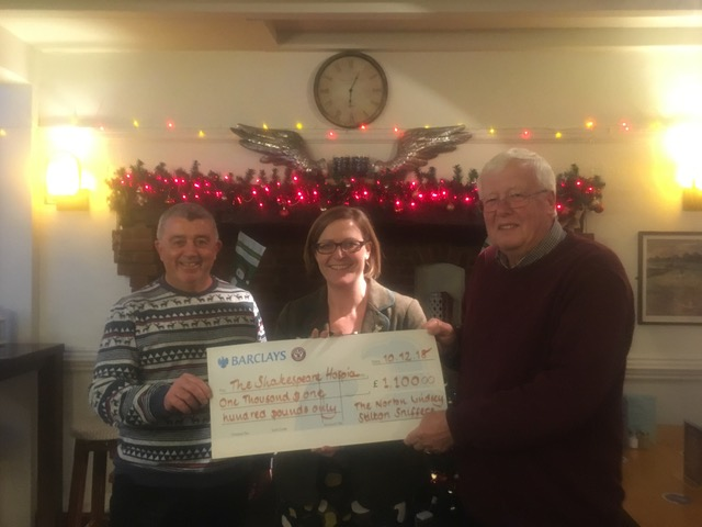 Sniffers handing cheque to Shakespeare Hospice
