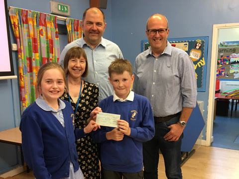 Sniffers handing cheque to Wolverton Primary School
